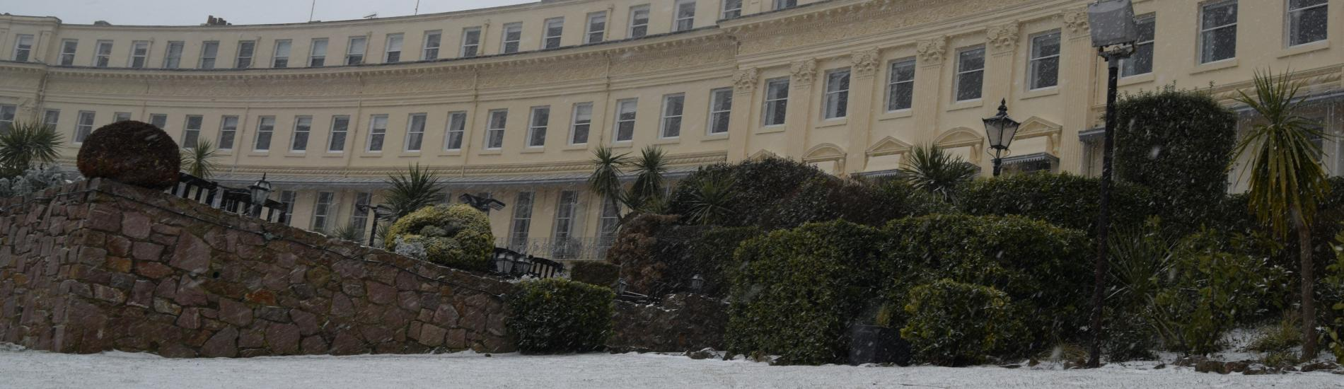 Osborne hotel front with grounds covered in snow